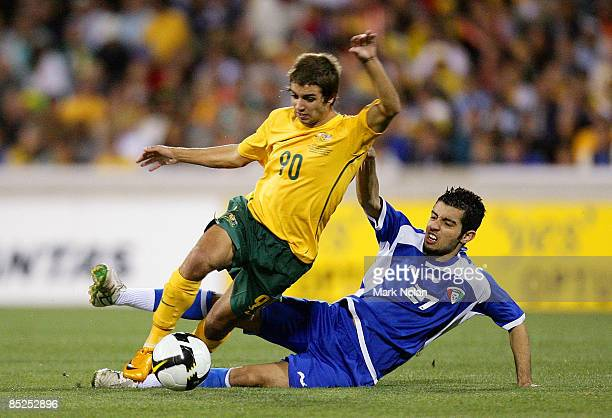 Michael Zullo of Australia is tackled by Talal Alamer of Kuwait during the AFC Asian Cup 2011 qualifier match between Australia and Kuwait at...