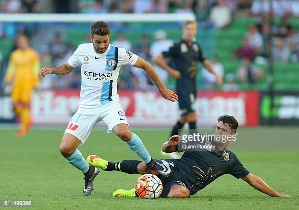 Michael Zullo of City is tackled by Fabio Ferreira of the Mariners during the round 20 ALeague match between Melbourne City FC and the Central Coast...