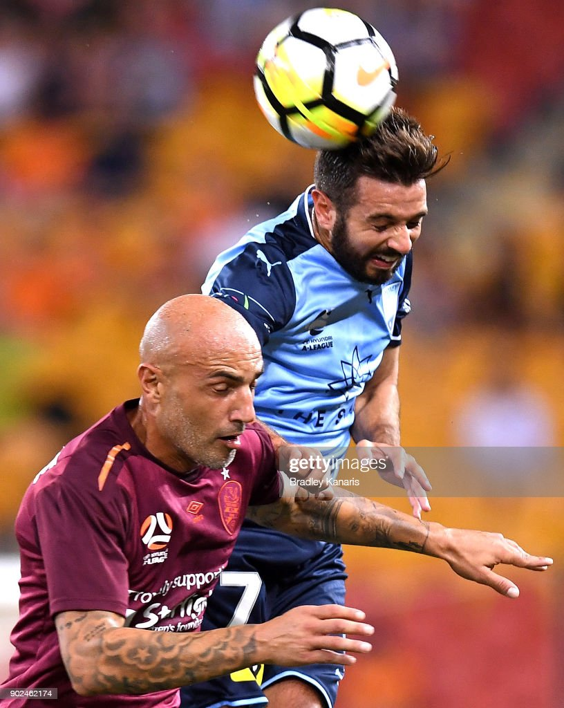 Michael Zullo of Sydney and Massimo Maccarone of the Roar challenge for the ball during the round 15 A-League match between the Brisbane Roar and Sydney FC at Suncorp Stadium on January 8, 2018 in Brisbane, Australia.