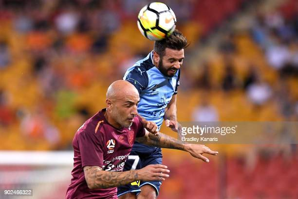 Michael Zullo of Sydney and Massimo Maccarone of the Roar challenge for the ball during the round 15 ALeague match between the Brisbane Roar and...