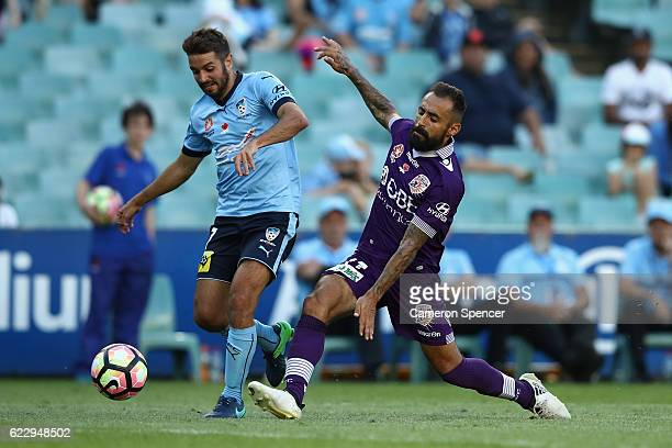 Michael Zullo of Sydney FC and Diego Castro of the Glory contest the ball during the round six ALeague match between the Sydney Kings and the Perth...