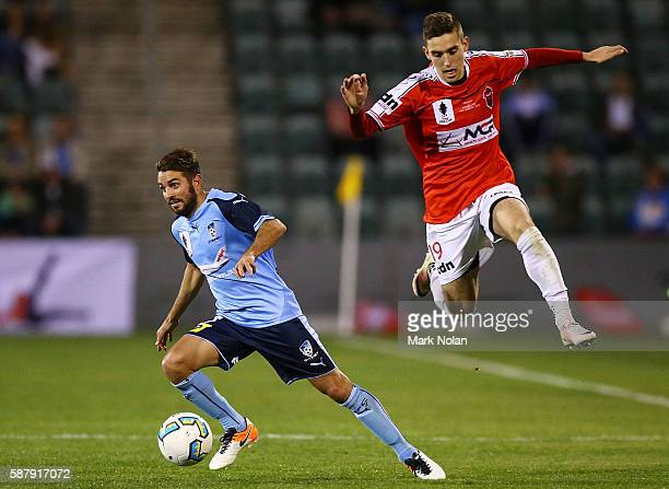 Michael Zullo of Sydney FC and Joshua MacDonald of the Wolves contest possession during the FFA Cup round of 32 match between the Wollongong Wolves...