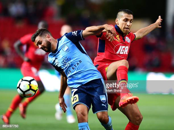Michael Zullo of Sydney FC and Karim Matmour of Adelaide United during the round nine ALeague match between the Adelaide 36ers and the Sydney Kings...