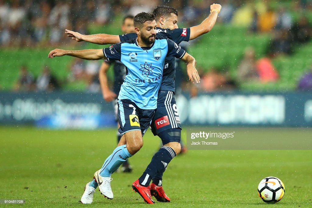 Michael Zullo of Sydney FC (L) and Kosta Barbarouses of the Victory compete for the ball during the round 18 A-League match between Melbourne Victory and Sydney FC at AAMI Park on January 26, 2018 in Melbourne, Australia.
