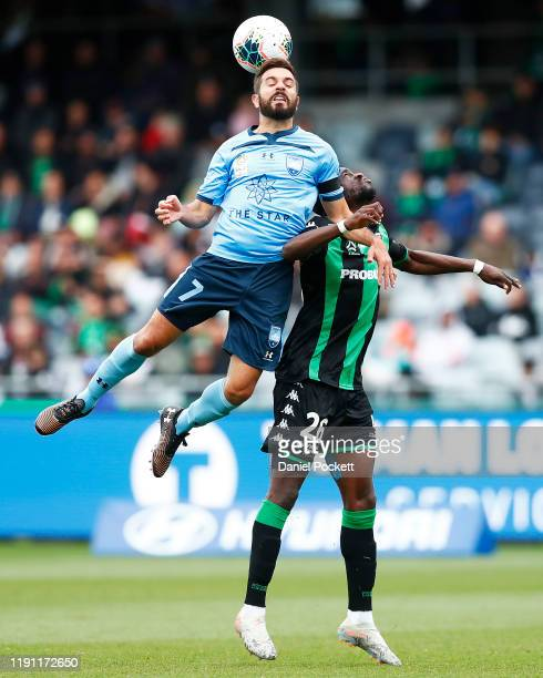 Michael Zullo of Sydney FC and Kwabena Appiah-Kubi of Western United contest the ball during the round eight A-League match between Western United...