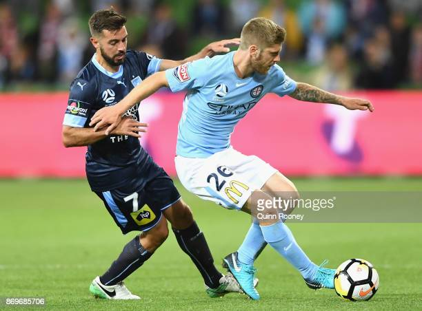Michael Zullo of Sydney FC and Luke Brattan of the City compete for the ball during the round five ALeague match between Melbourne City FC and Sydney...