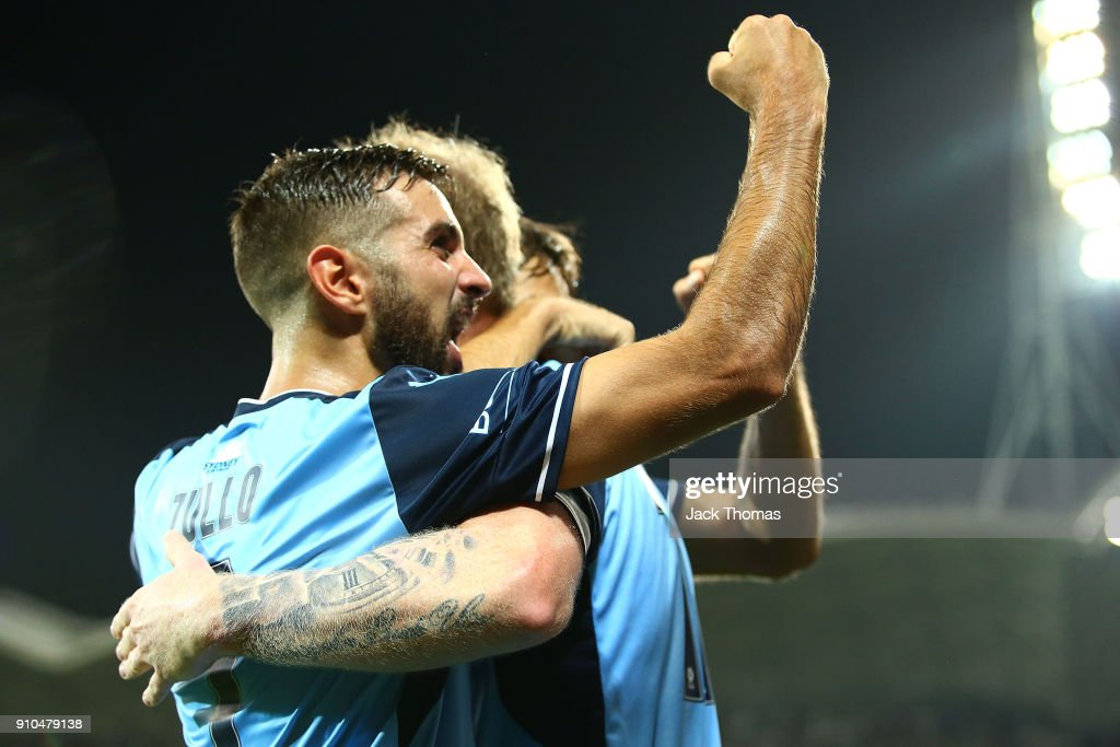 Michael Zullo of Sydney FC celebrates David Carney of Sydney FC goal during the round 18 A-League match between Melbourne Victory and Sydney FC at AAMI Park on January 26, 2018 in Melbourne, Australia.