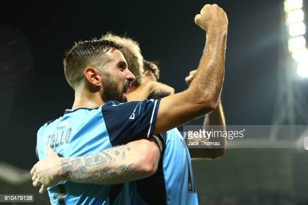 Michael Zullo of Sydney FC celebrates David Carney of Sydney FC goal during the round 18 ALeague match between Melbourne Victory and Sydney FC at...
