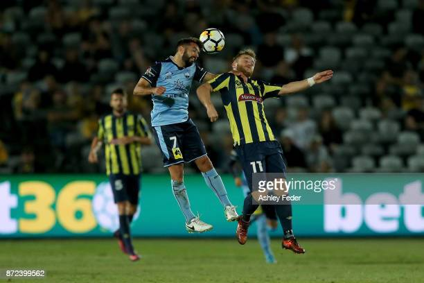 Michael Zullo of Sydney FC contests the ball against Connor Pain of the Mariners during the round six ALeague match between the Central Coast...