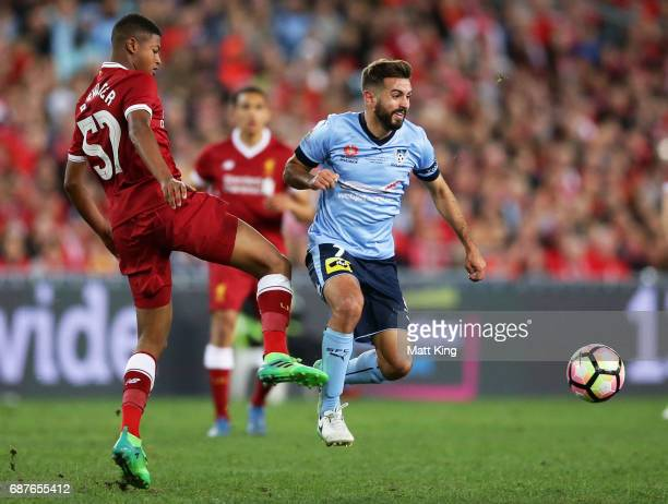 Michael Zullo of Sydney FC is challenged by Rhian Brewster of Liverpool during the International Friendly match between Sydney FC and Liverpool FC at...