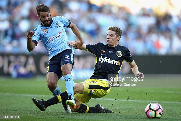 Michael Zullo of Sydney FC tackles Trent Buhagiar of the Mariners during the round two A-League match between Sydney FC and the Central Coast...