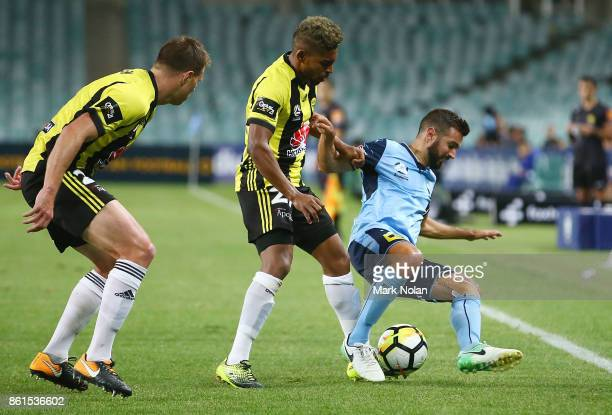 Michael Zullo of Sydney is tackled during the round two ALeague match between Sydney FC and the Wellington Phoenix at Allianz Stadium on October 15...