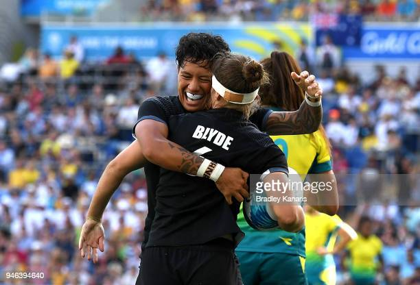Michaela Blyde of New Zealand is congratulated by team mate Gayle Broughton after scoring a try in the WomenÕs Gold Medal Final match between...
