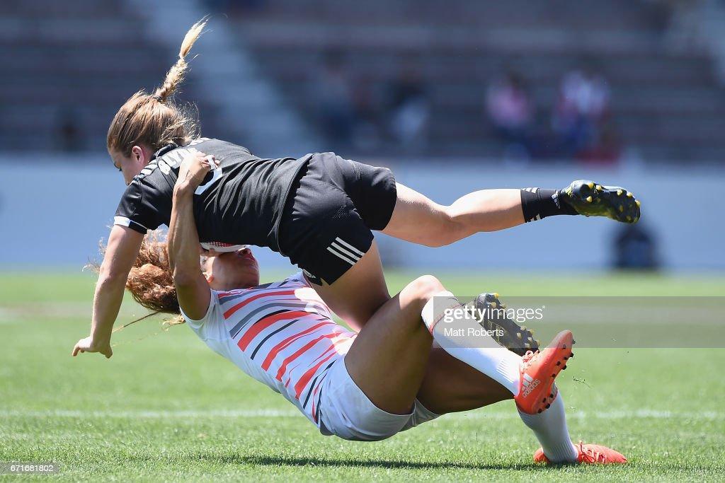 Michaela Blyde of New Zealand is tackled by KDeborah Fleming of England during the HSBC World Rugby Women's Sevens Series 2016/17 Kitakyushu quarter final between New Zealand and England at Kitakyushu Stadium on April 23, 2017 in Kitakyushu, Japan.