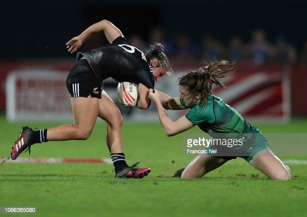 Michaela Blyde of New Zealand is tackled by Kristina Seredina of Ireland on day one of the Emirates Dubai Rugby Sevens HSBC World Rugby Sevens Series...
