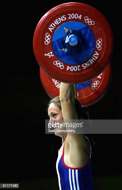 Michaela Breeze of Great Britain competes in the women's 58 kg category weightlifting competition on August 16 2004 during the Athens 2004 Summer...