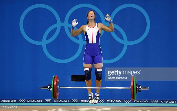 Michaela Breeze of Great Britain shows her dejection in the women's 58 kg category weightlifting competition on August 16 2004 during the Athens 2004...