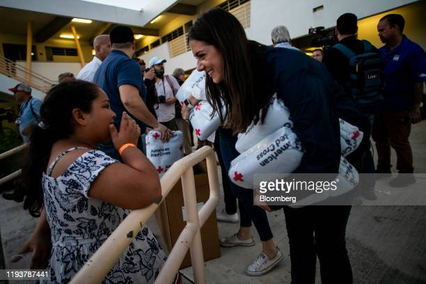 Michaela Cuomo speaks with a child while her father New York Governor Andrew Cuomo visits a temporary shelter in Ponce Puerto Rico on Tuesday Jan 14...