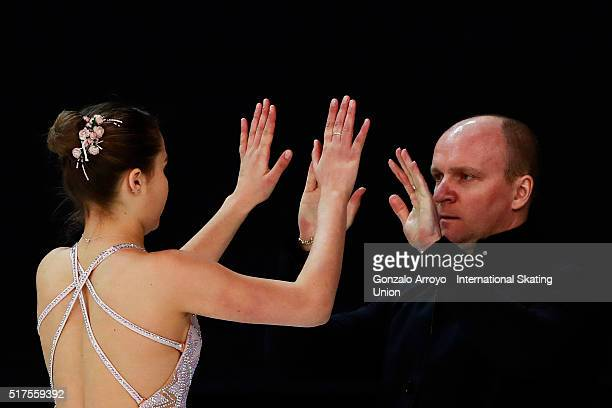 Michaela Du Toit from South Africa clashes hands with her coach prior to start her show the Ladie's short program of the ISU World Junior Figure...