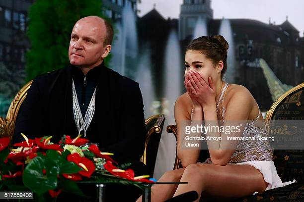 Michaela Du Toit from South Africa listens to her score with her coach at the kiss and cry are prior to start her show the Ladie's short program of...