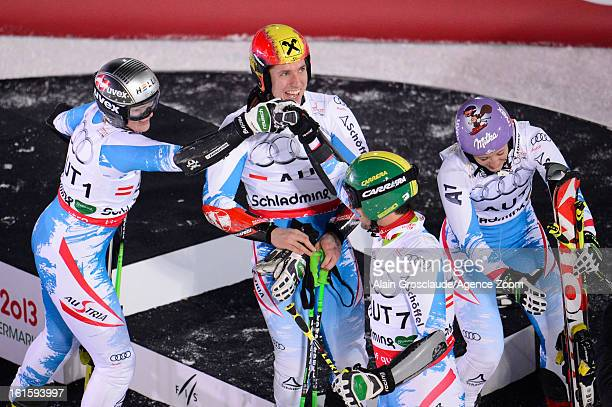 Michaela Kirchgasser Nicole Hosp Philipp Schoerghofer and Marcel Hirscher of Austria win the gold medal during the Audi FIS Alpine Ski World...