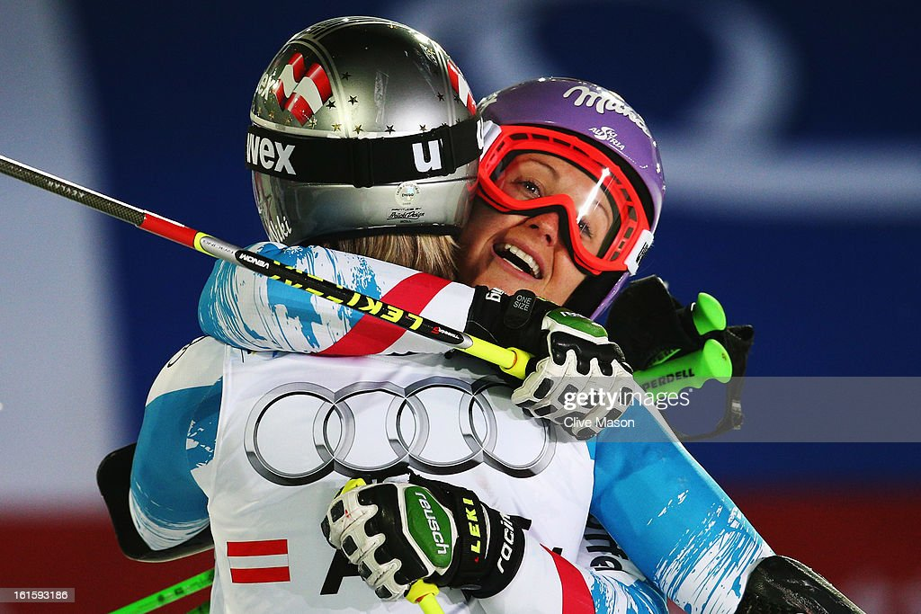 Michaela Kirchgasser (R) of Austria celebrates with team mate Nicole Hosp as Austria win the Men and Women's Nations Team Event during the Alpine FIS Ski World Championships on February 12, 2013 in Schladming, Austria.