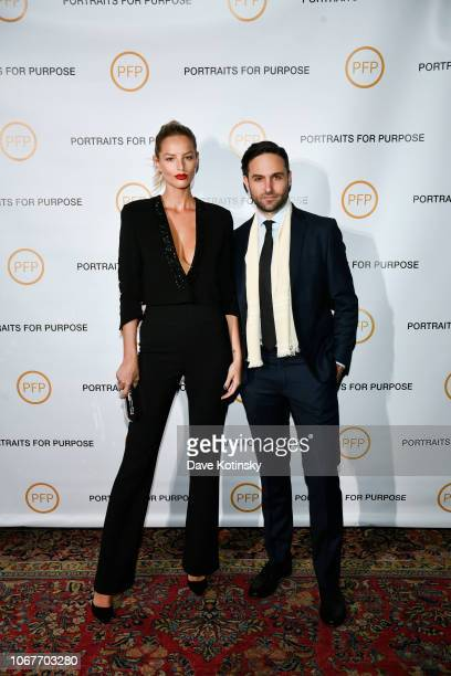 Michaela Kocianova and Tyler Loftis attend Portraits For Purpose Paintings By Tyler Loftis at the Bowery Hotel on November 14 2018 in New York City