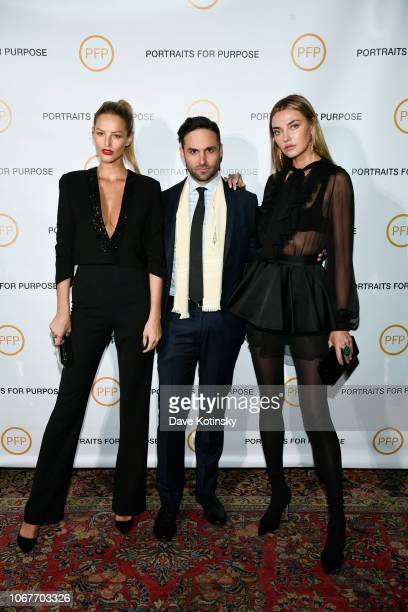 Michaela Kocianova Tyler Loftis and Alina Baikova attend Portraits For Purpose Paintings By Tyler Loftis at the Bowery Hotel on November 14 2018 in...