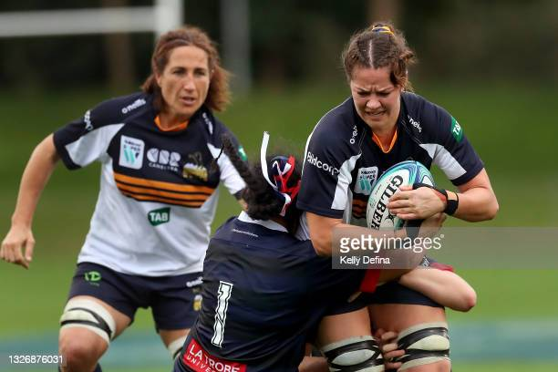Michaela Leonard of the Brumbies is tackled by Janita Kareta of the Rebels during the Super W match between the Melbourne Rebels and the ACT Brumbies...