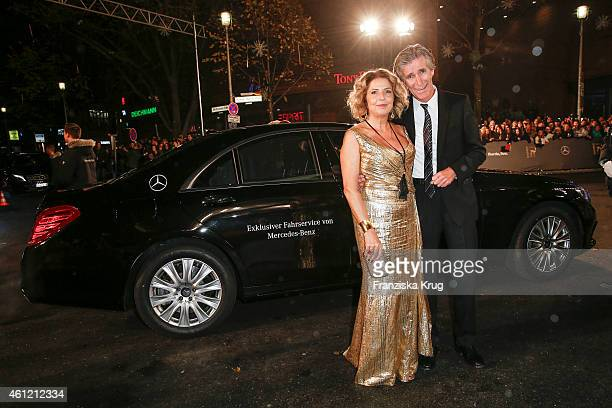 Michaela May and Bernd Schadewald arrive at the Bambi Awards 2014 on November 13 2014 in Berlin Germany