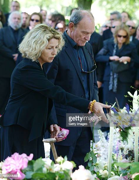 Michaela May and Michael Mendel attend the funeral of German actress Barbara Rudnik at Nordfriedhof cemetery on May 29 2009 in Munich Germany