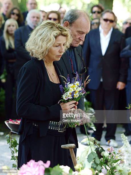 Michaela May and Michael Mendl attend the funeral of German actress Barbara Rudnik at Nordfriedhof cemetery on May 29 2009 in Munich Germany