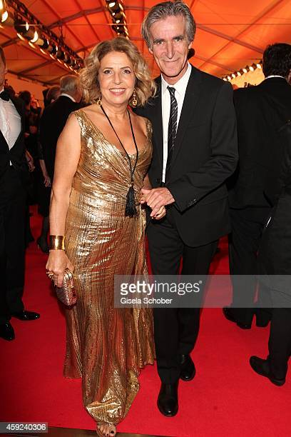 Michaela May wearing a dress by AIGNER and her husband Bernd Schadewald arrive at the Bambi Awards 2014 on November 13 2014 in Berlin Germany