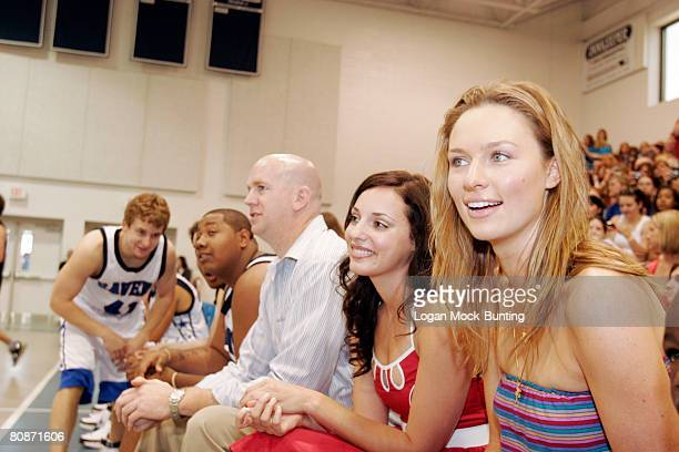 Michaela McManus and Lisa Goldstein watch during the 5th Annual James Lafferty/One Tree Hill Charity Basketball Game on the campus of Cape Fear...