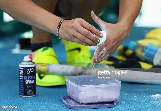 Michaela Meijer of Sweden applies chalk to her hands during the Women's Pole Vault Qualifying Round Group A on Day 11 of the Rio 2016 Olympic Games...