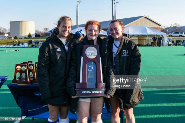 Michaela Nicholas Caitlin Morrissey and Melissa Gula of Franklin Marshall stand with the national runnerup trophy following the Division III Women's...