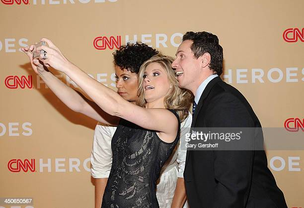 Michaela Pereira Kate Boulduan and Chris Cuomo shoot 'selfies' on the red carpet at the 2013 CNN Heroes An All Star Tribute at The American Museum of...