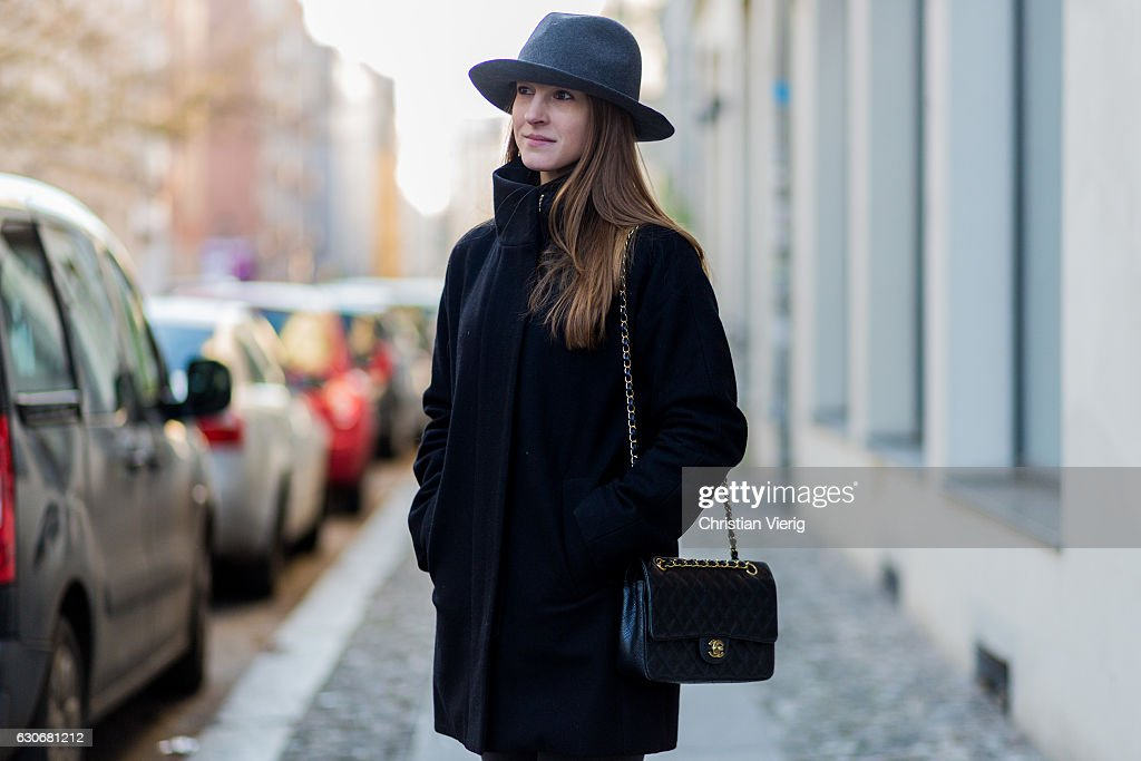6d59f19d2 Michaela Rosmarin wearing a black wool jackt, grey hat, black Chanel ...