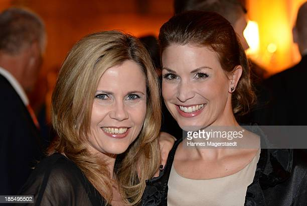 Michaela Schaffrath and Claudia Pupeter attend the presentation of Manfred Baumann New Calendar 2014 at the King's Hotel Center on October 21 2013 in...