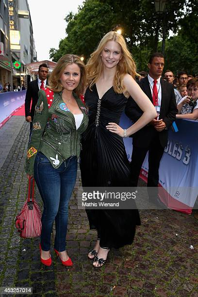 Michaela Schaffrath and guest attend the premiere of the film 'The Expendables 3' at Residenz Kino on August 6 2014 in Cologne Germany