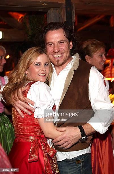 Michaela Schaffrath and her boyfriend Carlos Anthonyo during Oktoberfest at Kaeferzetl/Theresienwiese on October 5 2014 in Munich Germany