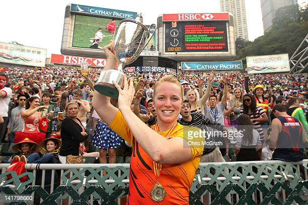 Michaela Staniford of England poses with the trophy in front of the south stand after defeating Australia during the Women's Seven's Challenge Cup...