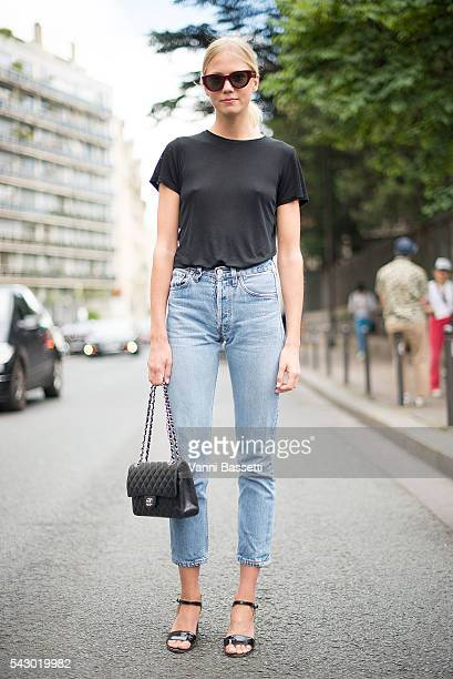 Michaela Thomsen poses wearing Levis jeans and Chanel bag after the Etudes show during Paris Menswear Fashion Week SS17 on June 25 2016 in Paris...