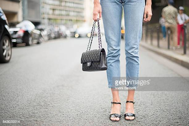 Michaela Thomsen poses wearing Levis jeans and Chanel bag after the Etudes show during Paris Menswear Fashion Week SS17 on June 25, 2016 in Paris,...