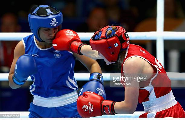 Michaela Walsh of Northen Ireland competes against Pinki Rani of India during the Women's Fly 4851 kg SemiFinals Boxing at Scottish Exhibition And...