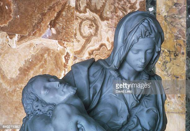 Michaelangelo's Pieta at St Peter's Rome The work was commissioned in 1498 and completed at the turn of the century | Detail of 'Pieta' by...