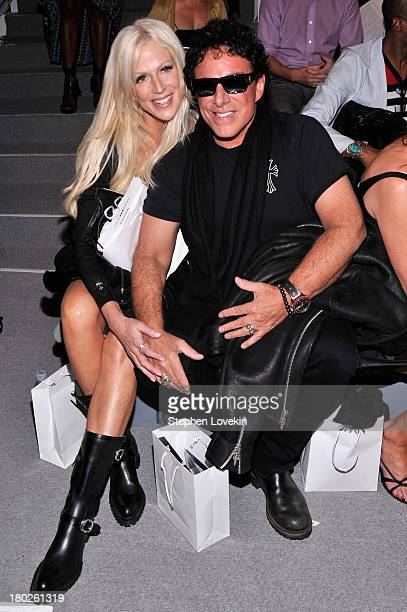 Michaele Salahi and musician Neal Schon attend the Zang Toi fashion show during MercedesBenz Fashion Week Spring 2014 at The Stage at Lincoln Center...