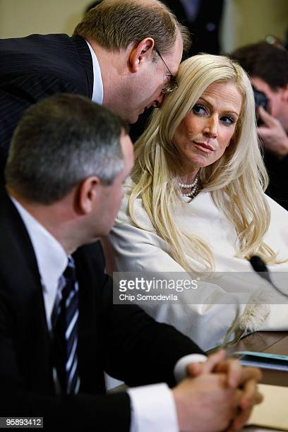 Michaele Salahi listens to her lawyer Stephen Best as she and her husband Tareq Salahi prepare to testify to the House Homeland Security Committee...