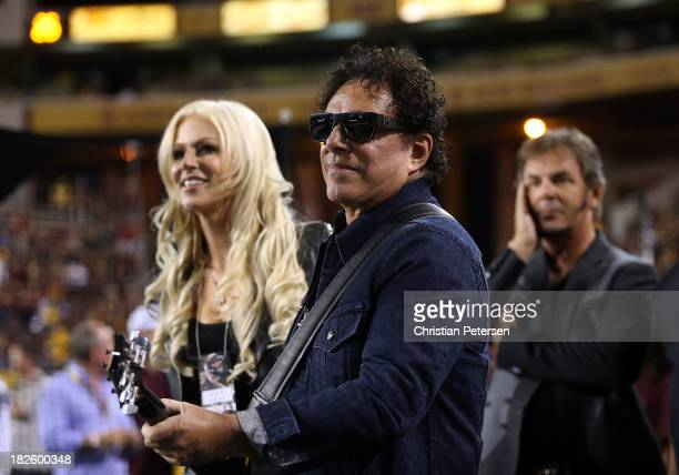 Michaele Salahi Neal Schon and Jonathan Cain of Journey before performing the National Anthem at the college football game between the Arizona State...