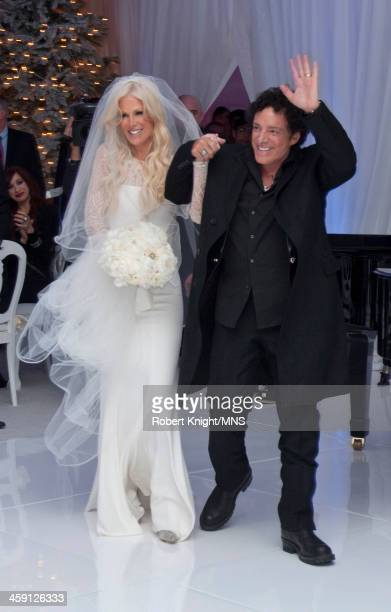 Michaele Schon and Neal Schon attend their wedding at the Palace of Fine Arts on December 15 2013 in San Francisco California